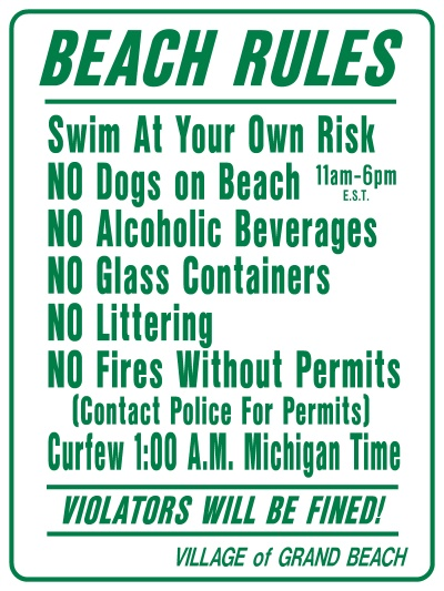This is a picture of a sign with the beach rules for Grand Beach.